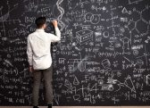 A person looking at a blackboard Description automatically generated with low confidence